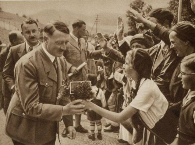 Adolf-Hitler-receiving-Flowers
