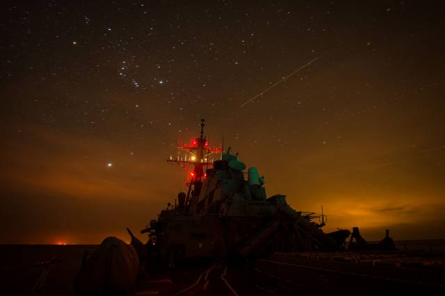 uss-mitscher-ddg-57-lights-up-its-mast-during-night-delayed-landing-qualifications-with-the-desert-hawks-of-helicopter-sea-combat-squadron-hsc-26
