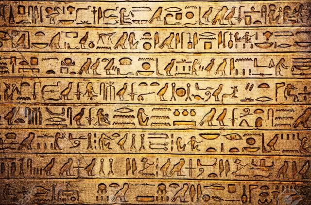 9897627-egyptian-hieroglyphs-on-the-wall-stock-photo-egyptian-hieroglyphics-hieroglyph