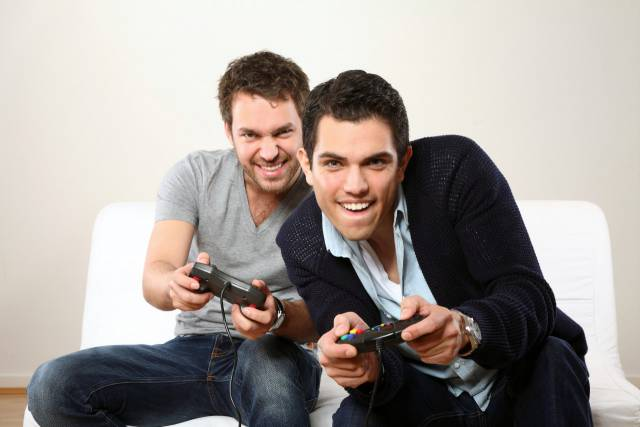 two-young-man-playing-and-smiling